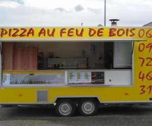 Camion jaune pizzas au feu de bois